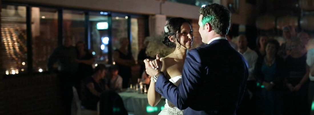 bride and groom having their first dance at Sirromet Winery's Barrel Hall