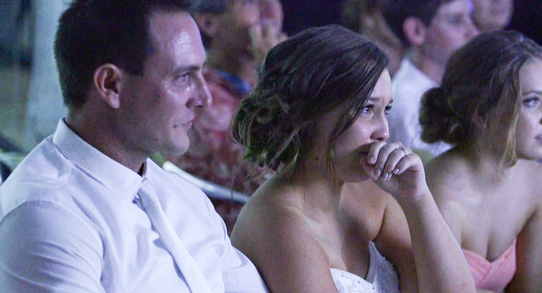 Naryssa & Mark watching their same day edit at their reception.