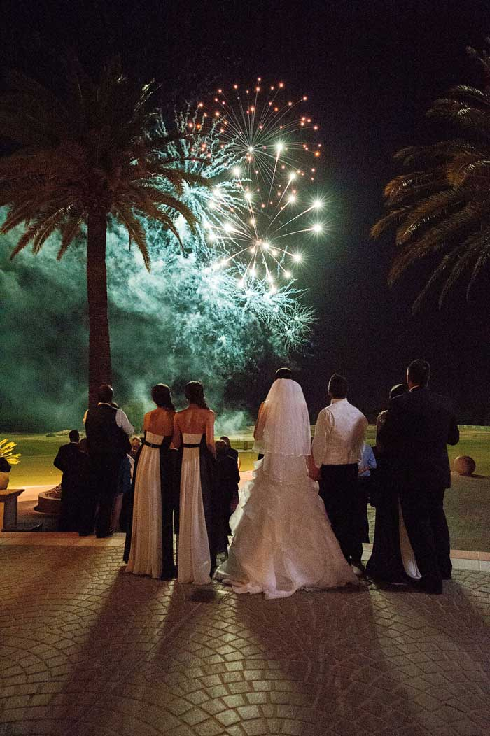 bride and groom watch fireworks at links hope island on the gold coast
