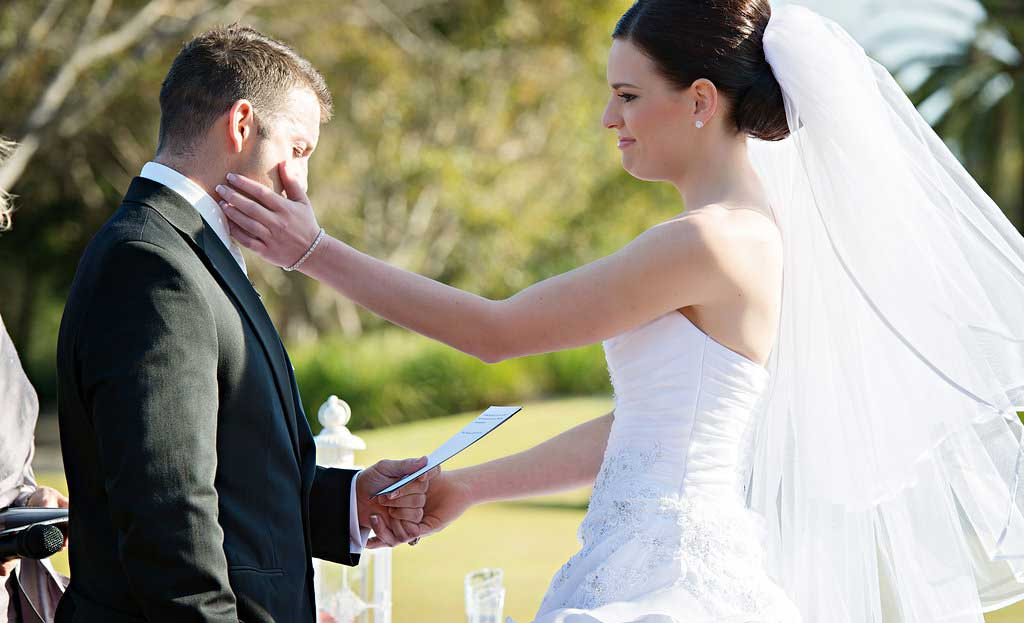 groom cries during vows at a wedding ceremony at links hope island