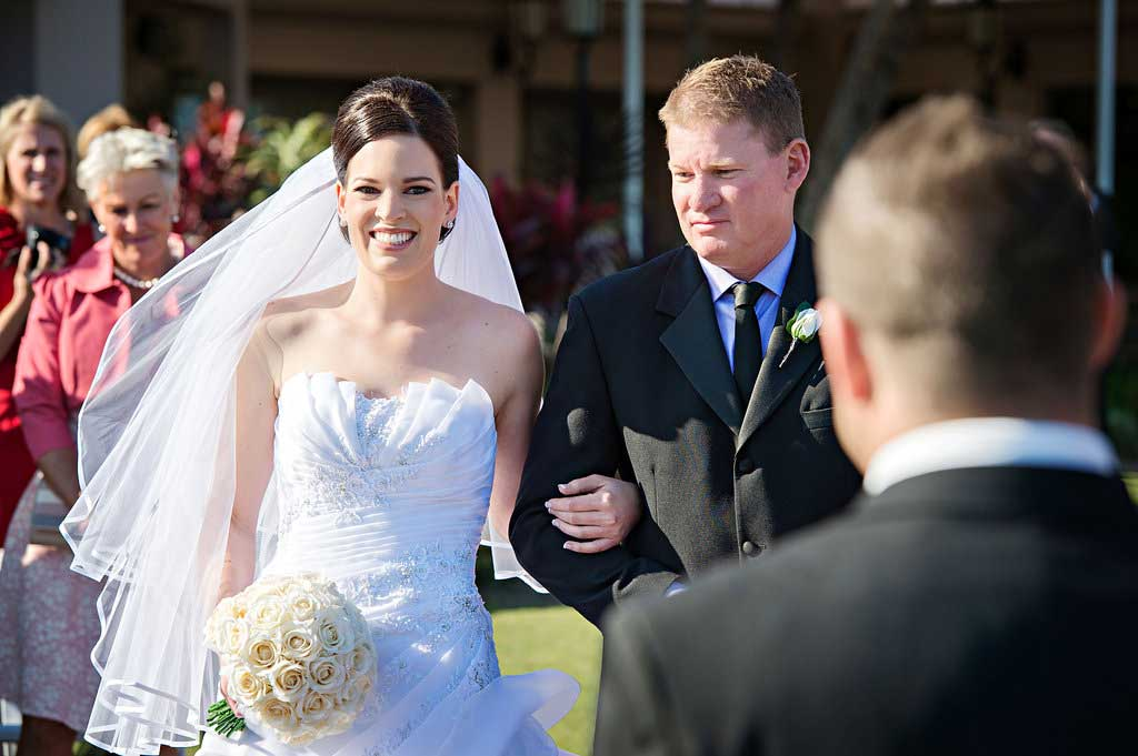 bride walks down the aisle at links hope island on the gold coast