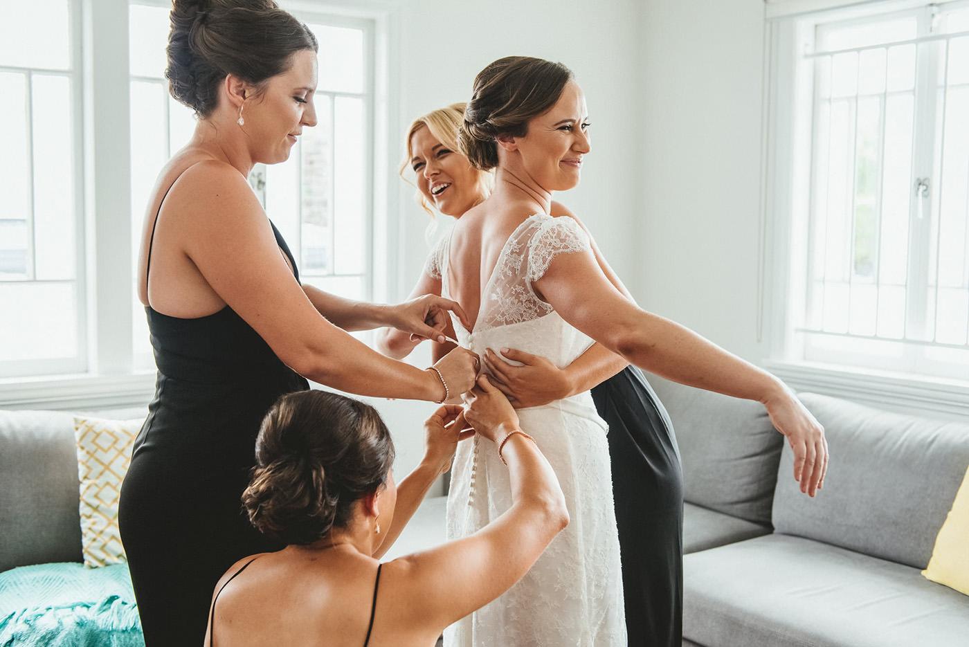 Bride gets in her wedding dress